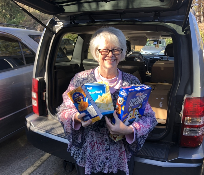 Frank Cawood and Associates Donate Needed Food Items